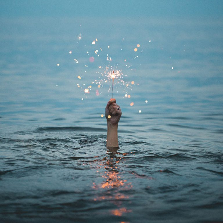 Life Coaching - Hand out of water with a sparkler